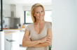 canvas print picture - 40-year-old blond woman standing inside house