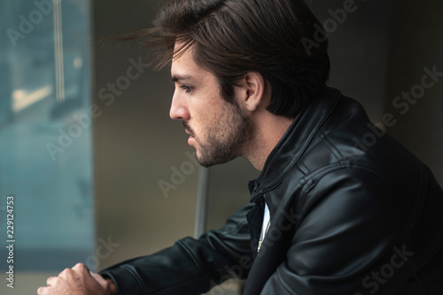 Portrait Of Handsome Confident Young Man Looking Through The