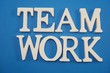 teamwork text letters alphabet on blue background