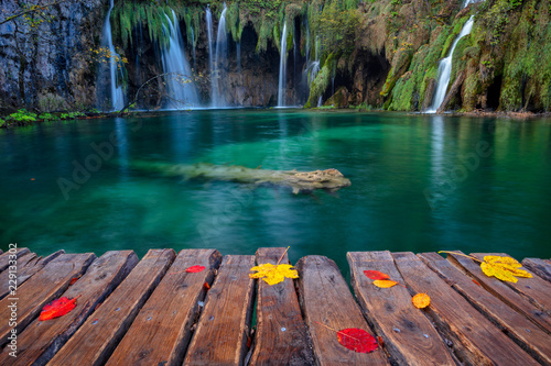 Spoed Foto op Canvas Cappuccino Plitvice Lakes. Image of waterfall located in Plitvice National Park, Croatia during autumn day.