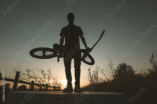 Young man with a bmx bicycle