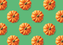 Colorful Pattern Of Orange Pumpkins On Green Background