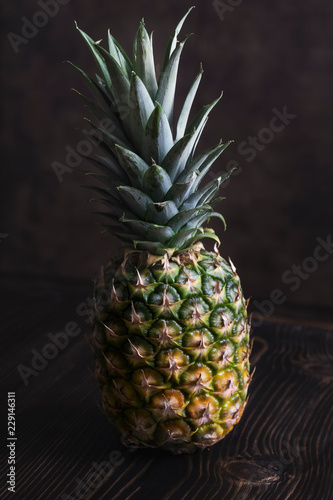 Fototapety, obrazy: Ripe pineapple on a  wooden table