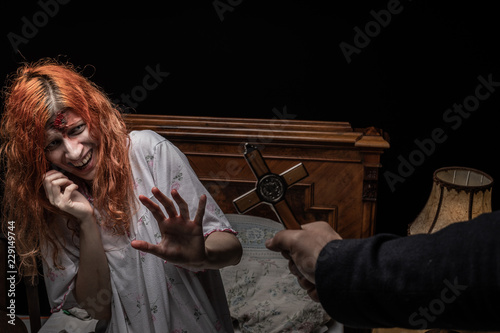 Cuadros en Lienzo Scary woman possessed by devil in the bed. Exorcism of priest.