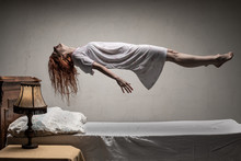 Woman Levitating Over Bed / As...