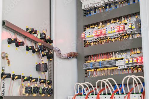 an open fuse box is on the wall in the basement  high voltage electrical  control