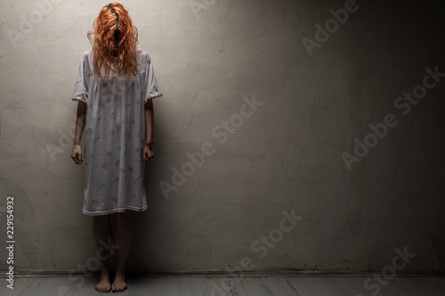 Scary ghost woman in nightgown with knife / halloween, zombie concept Fototapete