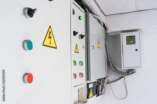 a few fuse boxes are installed on the wall in the basement  high voltage  electrical