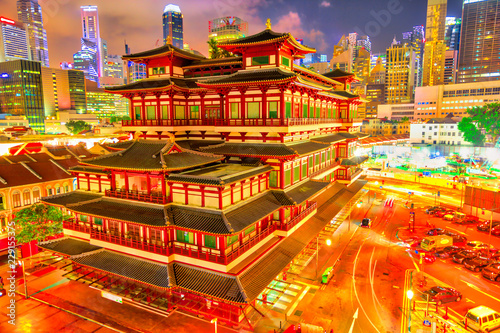 Buddha Tooth Relic Temple of Singapore from aerial view, Southeast Asia. Spectacular buddhist temple in Chinatown district with business district skyline on background by night.