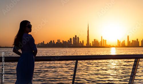 Canvas Prints Kuala Lumpur Woman enjoying Dubai view at sunset