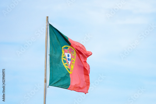Fotografia  Portuguese flag waving on the strong wind