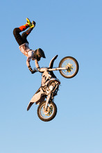 Freestyle Motocross Rider Performs The Trick In Jump At Fmx Competitions