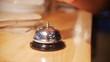 Man rings in restaurant bell. Slow motion