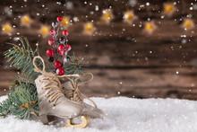 Christmas Decoration Ice Skates On Wooden Background