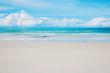 White sand on beach.