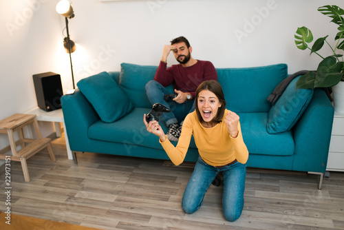 Cute Couple Playing Video Games Together At Home Girl Is Winning And Laughing While The Loser Guy Is Upset Buy This Stock Photo And Explore Similar Images At Adobe Stock