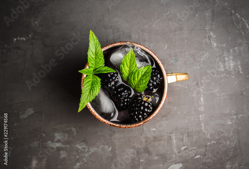 Blackberry moscow mule in copper mug on the rustic background Canvas-taulu
