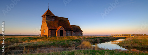Fotografie, Obraz  Autumnal clear evening sunset over St Thomas a Becket Church, Fairfield, in the
