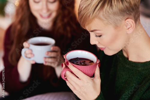 Girl drinking hot tea or mulled wine