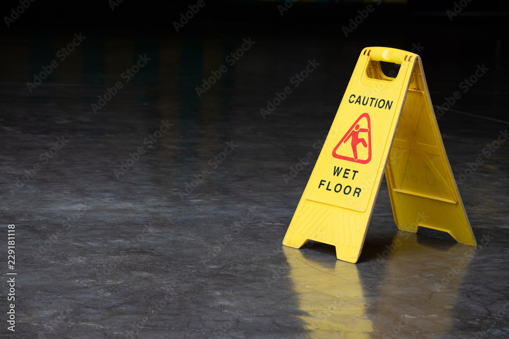 Fototapety, obrazy: wet floor sign on cement ground. yellow plastic warning sign.
