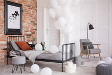 Balloons In Industrial Stylish Bedroom With Grey Accents And Map In Black Frame, Real Photo With Copy Space