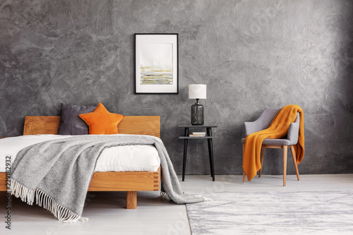 Grey and orange accents in simple and elegant bedroom with king size bed and pai Wallpaper Mural
