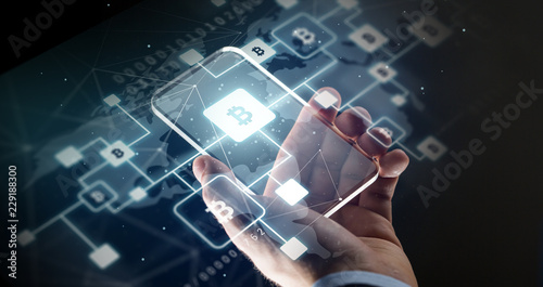 Fotografía  business, cryptocurrency and future technology concept - close up of hand with v