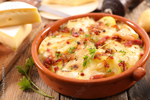 Fototapeta tartiflette, baked potato, bacon and cheese obraz