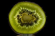 Sliced Kiwi Fruit With Back Light Isolated On Black Background