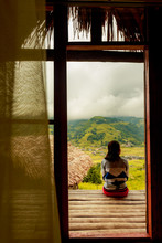 Alone Women Sit On Terrace And See The Mountain View On His Vacation In Sapa Vietnam.