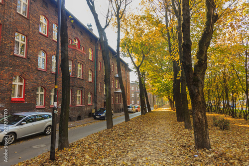 Street in Historic Mining District of Nikiszowiec in Katowice in Polish Silesia. On the left red-brick houses in which the miner's family lived