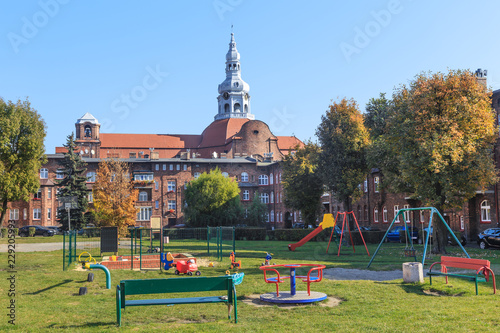 Historic Mining District of Nikiszowiec in Katowice in Polish Silesia. A playground for children located in the yard surrounded by tenement houses