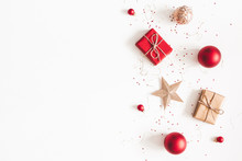 Christmas Composition. Christmas Gifts, Red And Golden Decorations On White Background. Flat Lay, Top View, Copy Space