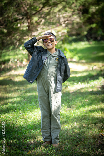 Boy in Maverick Pilot costume and aviator sunglasses Wallpaper Mural