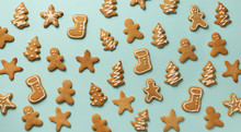 Christmas Gingerbread Cookies On Blue Background. Banner. Top View, Copy Space. New Year Concept