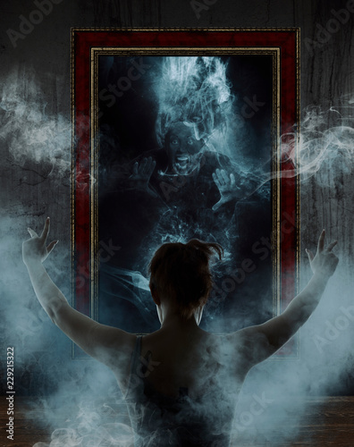 Cuadros en Lienzo Mirror. Terrible ghost on dark smoke