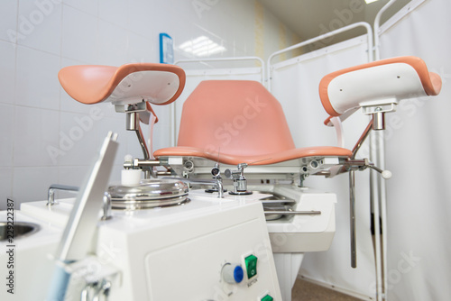 Valokuva  Gynecological cabinet with chair and other medical equipment in modern clinic