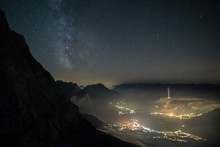 Milky Way Shot From High Above, With The Still Illuminated City