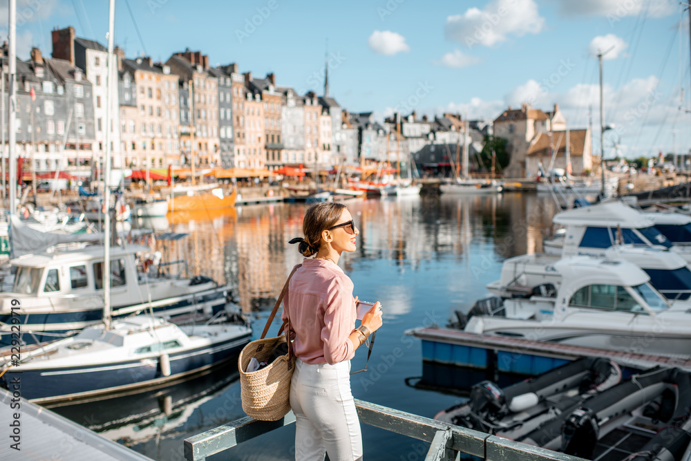 Fototapety, obrazy: Young woman tourist enjoying beautiful view on the harbour traveling in Honfleur town in Normandy, France