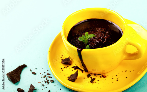 Spoed Foto op Canvas Chocolade Hot Chocolate with Green Mint in Yellow Cup Drink Dessert on Colorful Background