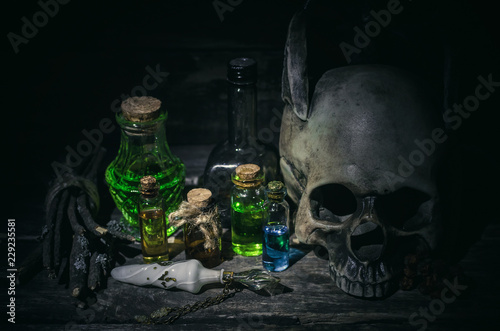 Fototapeta Magic potion and human skull on magic table background. Witchcraft concept. obraz