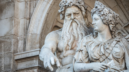 Fototapeta Neptune and his wife Salacia fountain near Albertina and Hofburg Palace in Vienn