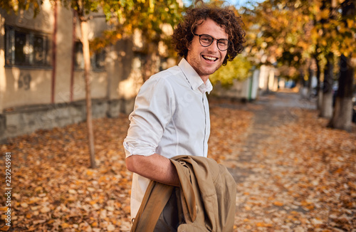 Fotografía Horizontal potrait of young businessman with glasses posing outdoors going to the lunch