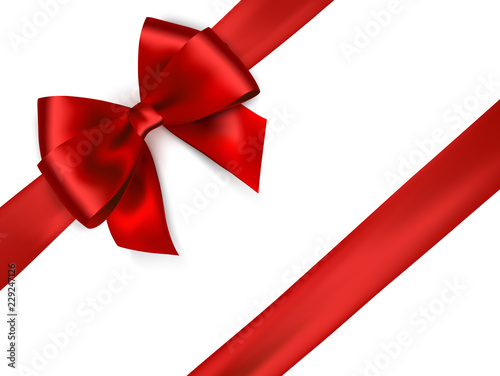 Foto Shiny red satin ribbon on white background.