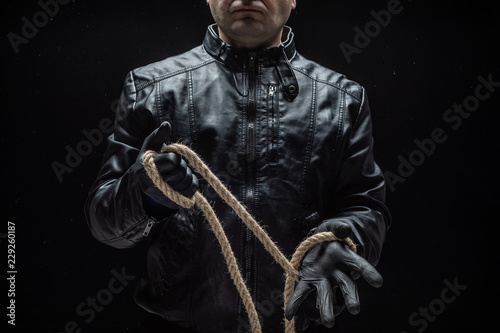 Fotografie, Obraz  Serial killer with rope / heloween concept