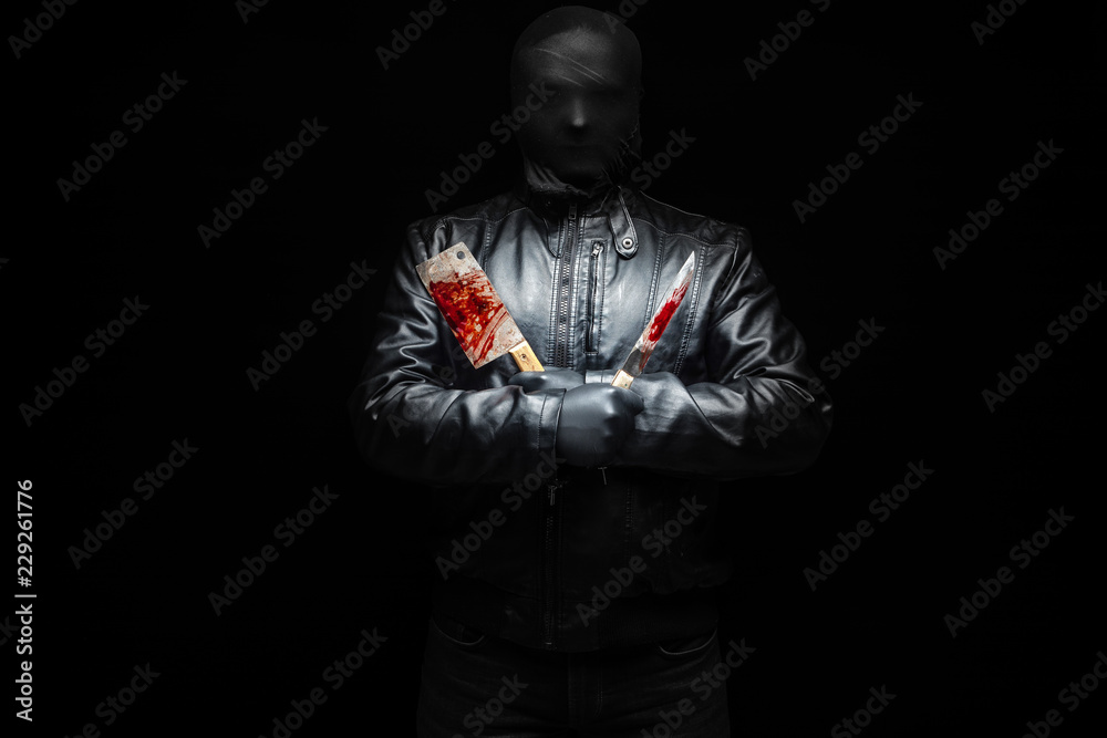 Fototapeta Serial killer hand with bloody killer tools and black gloves