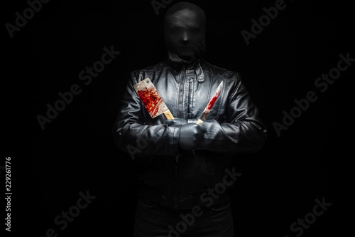 Serial killer hand with bloody killer tools and black gloves Wallpaper Mural