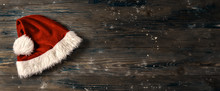 Flat Lay Of Santa's Hat On Wooden Background