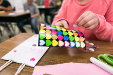 Classroom: Girl Decorates With...