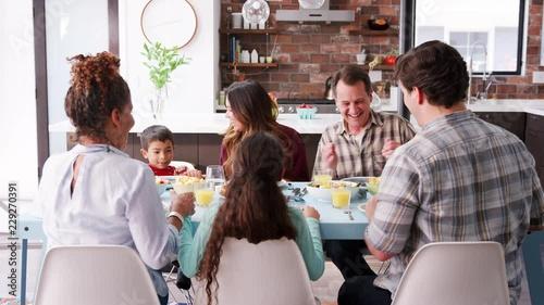 family praying around table - 427×240